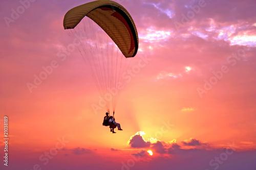 Flight of paraplane above Mediterranean sea on sunset - 21038189