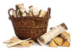birch firewood in a wicker basket and kindling