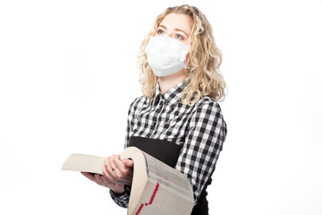 blond with encyclopedia in medical mask against viruses