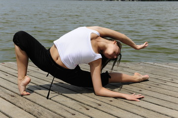 flexible woman stretching outdoors