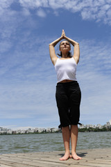 womanm meditataing outdoors
