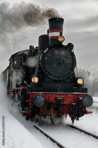 Old steam locomotive in the snow