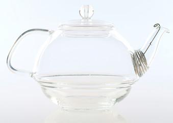 Glass tea pot isolated on white