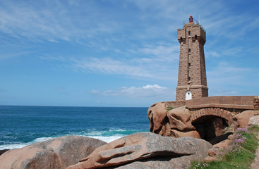 The lighthouse in Ploumenach in  brittany on pink granite rocks