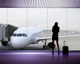 Fototapety Silhouette of woman at the airport