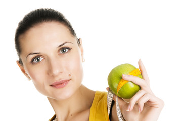 Beautiful slim woman holding a green apple