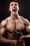 Scream of powerful muscular bodybuilder