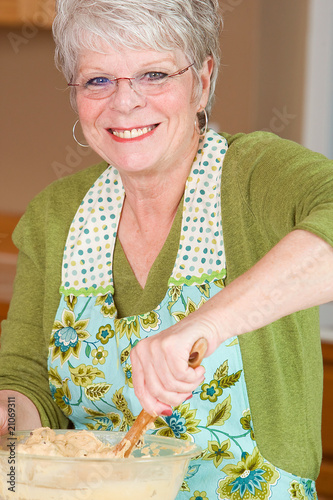 Mature Woman baking in the kitchen