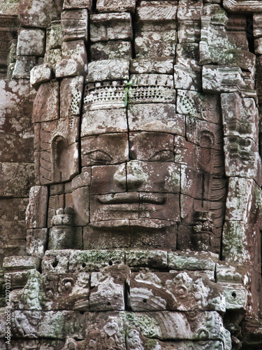 Smiling faces of ancient kings at the temples of Angkor Wat