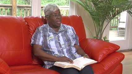 Senior woman reads bible - 123