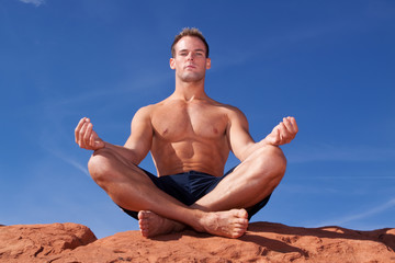 Man meditating outdoors