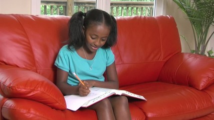 Girl does homework with ease