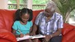 Senior woman helps granddaughter with homework - 119