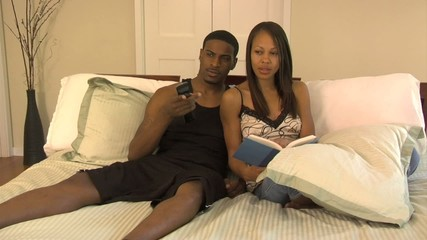Couple lounges on bed - 108