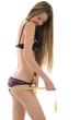 Slim girl measuring her buttocks
