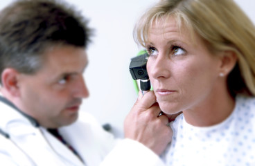 Physician examining patient