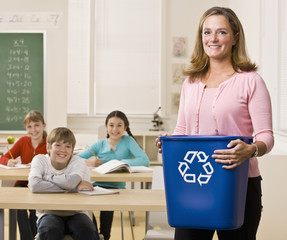 Teacher holding recycling bin
