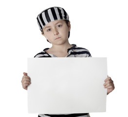 Sad child with prisoner costume and blank poster
