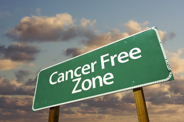 Cancer Free Zone Green Road Sign and Clouds