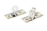Energy save lamp versus bulb on dollar bills isolated poster