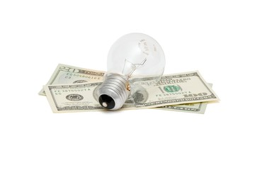 Electric bulb on dollar bills isolated