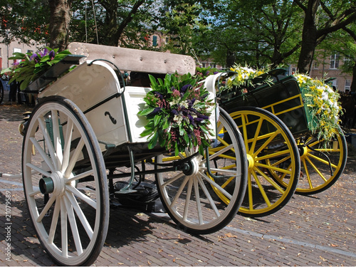 Two traditional flower decorated dutch cabriolet carriages