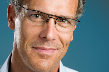Smiling mature man with glasses