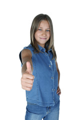 Portrait of young girl giving thumbs up, studio shot