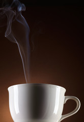 white cup steaming