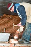 worker bricklayer during a brickwork poster