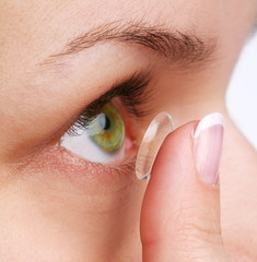 human eye with corrective lens on a white