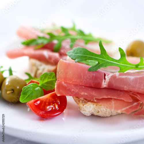 Canapes with prosciutto crudo