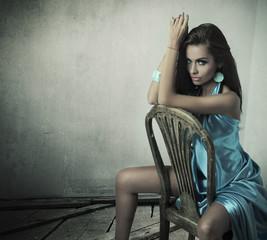 Stunning brunette beauty sitting on a chair