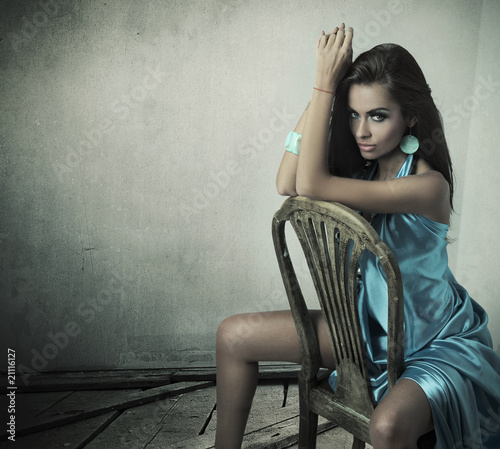 Stunning brunette beauty sitting on a chair