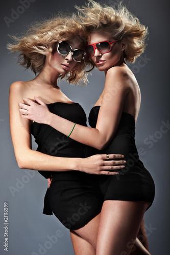Two blond women wearing sunglasses