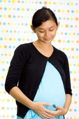 portrait of pregnant asian ethnic woman