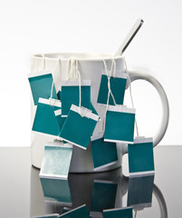 Cup of tea with many teabags