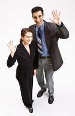 Business people waving