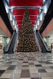 lighted christmas-tree modern shopping mall awaiting customers poster