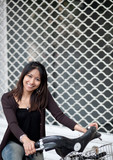 Very pretty young asian woman on bike smiling while commuting/bi poster