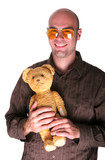 Infantil guy grin with his teddy bear poster