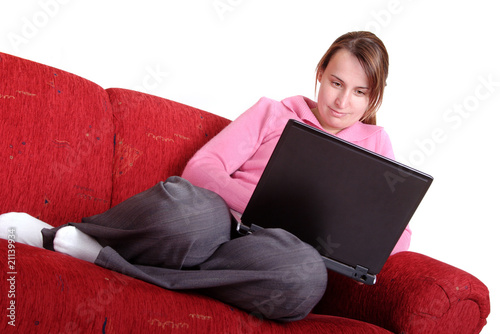 Young women on couch using laptop computer