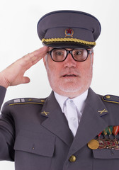 Uniformed soviet soldier in eyeglasses salute