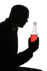Depressed man with bottle of alcohol