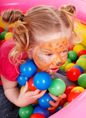 Little girl with group ball. Make up.