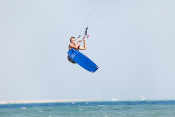 Kiteboarder jumps