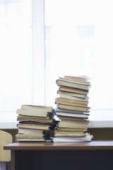 Books stacked on library table