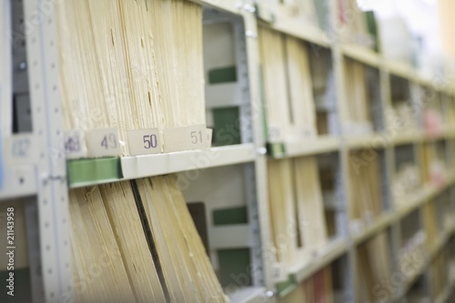 Colour coded filing system on library shelves