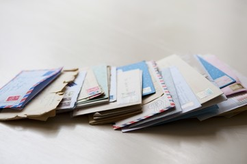 Letters with opened envelopes
