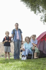 Mother, daughter and grand-children outside tent